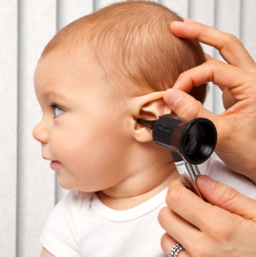 An 8 month old baby getting his ear checked.